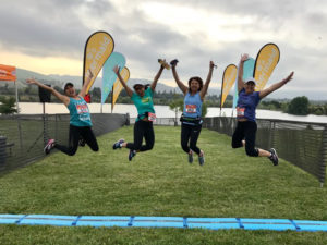 Runners jump over the finish line